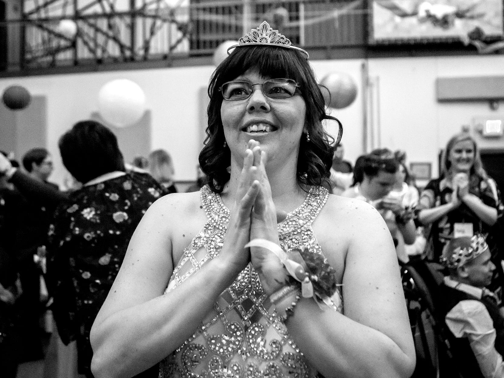 Heather Showman clasps her hands together after she, and every other guest at a Night to Shine were crowned prom king and queens. The dance which happens in churches across the world on the same night honors those with special needs by giving them a night they will always remember.
