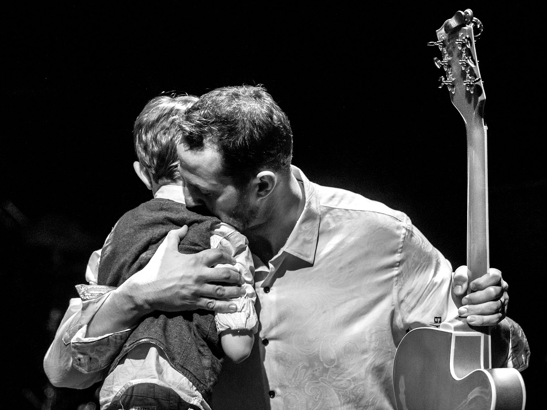 Ryan Metzger hugs his son, Leo, after they perform the encore song together at a fundraiser raising money for Williams syndrome and Autism Speaks. Leo who is 6 has been diagnosed with both disorders.