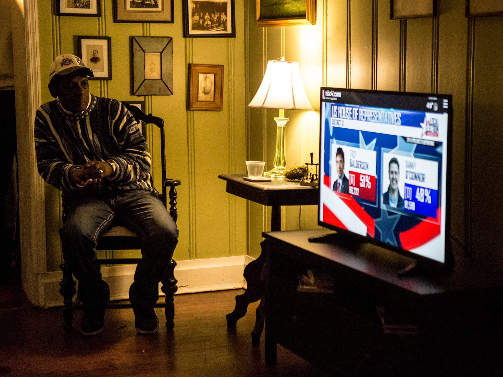 Chris Reed watches as election results roll in on election night. The Democratic Party held their election night watch party at the Orchard House in Granville.