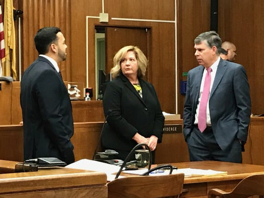 RML attorney Eileen Born, center, vists with defendant attorneys during one of the hearings.