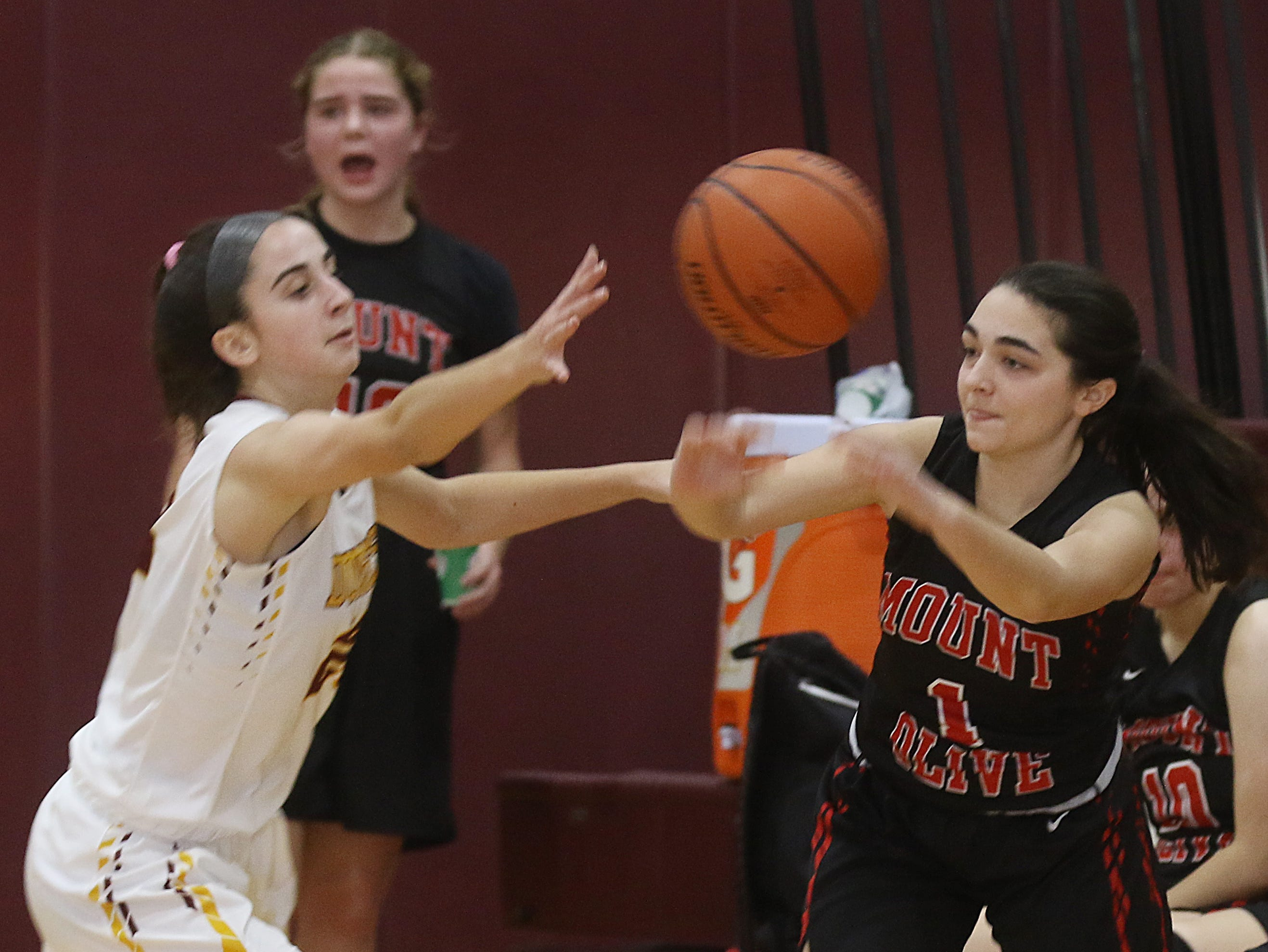 Maggie Perrello of Madison goes for the ball with Jessica Gault of Mount Olive late in the game.
