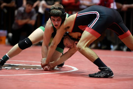 Pascack Valley's Tyler Pizzi and Westwood's Trent Furman wrestle in a 132-pound quarterfinal match on Day 1 of the BCCA holiday wrestling tournament on Thursday, Dec. 27, 2018, in Hackensack.