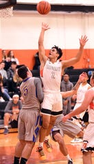 Fort Lee's Huasly Paredes (2), shown here in last month's win over Lyndhurst, made a game-winning three-pointer in the final seconds of a 59-58 win over Mahwah.