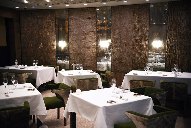 Repurposed tree bark has been used to create unique wood paneling at Restaurant Latour.
