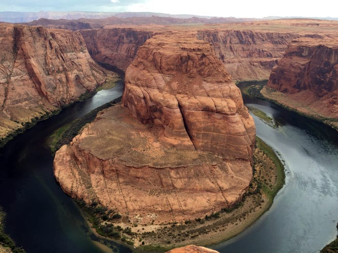 This Aug. 27, 2016, photo shows Horseshoe Bend near Page, Ariz. Authorities say a California girl visiting the Arizona landmark has died from what appears to be an accidental fall. Coconino County sheriff's officials said Wednesday, Dec. 26, 2018, that the body of the 14-year-old girl was found about 700 feet (213 meters) below Horseshoe Bend overlook.