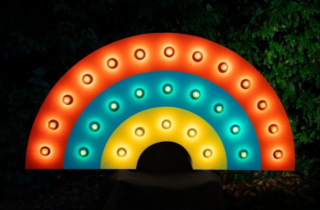 """Rainbow"" by artist Andy Arkley is made of wood, acrylic, light bulbs and wire. The piece will be among those in the exhibit titled ""Light Tricks"" by Arkley and his wife, Julie Alpert. The exhibition at the University Art Gallery at NMSU will run from Jan. 31 through March 3."