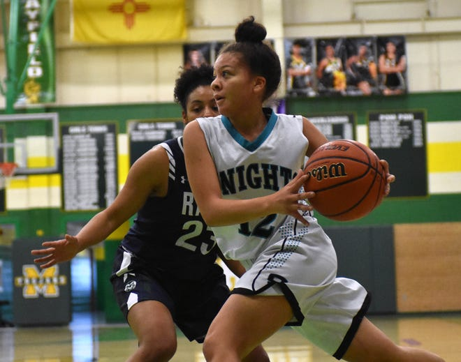Oñate High School's Angel Jones drives along the baseline against Rio Rancho on Thursday afternoon in the Holiday Hoopla Tournament at Mayfield High School. For complete first round results, click on this story at lcsun-news.com.