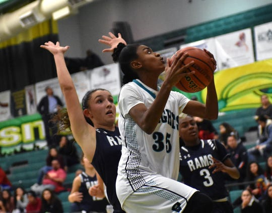 Oñate's Sydney Hobbs goes up for a lay up against Rio Rancho. For complete first round results, click on this story at lcsun-news.com.