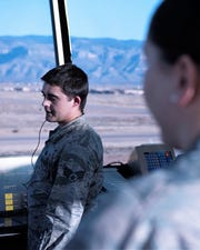 (From left to right) Senior Airman Jakob Powers, 54th Operations Support Squadron air traffic controller, gives a traffic call while being observed by Staff Sgt. Kristin Owens, 54th OSS watch supervisor, Dec. 18, 2018, on Holloman Air Force Base, N.M. Holloman is home to one of the most complex airfields in the Air Force because all three of the runways intersect in the shape of the number four.