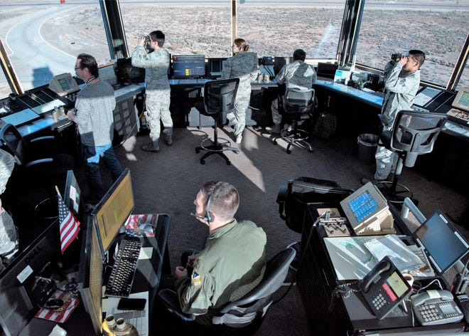 54th Operations Support Squadron air traffic controllers observe F-16 Fighting Falcons taking off, Dec. 18, 2018, on Holloman Air Force Base, N.M. The air traffic control tower is divided into five positions with unique responsibilities including ground transportation, flight data, local control, the watch supervisor desk and the supervisor of flight desk.