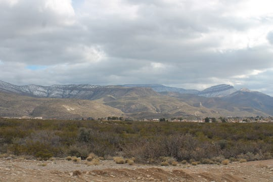 Snow can be seen on the peaks of the Sacramento Mountains on Thursday, Dec. 27, the result of one of two winter storms rolling through the Tularosa Basin this week.