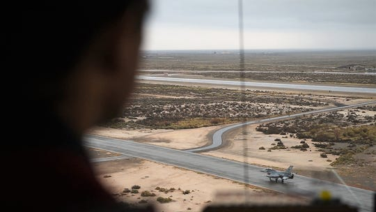 A 54th Operations Support Squadron air traffic controller observes an F-16 Fighting Falcon taxi near Badger Road, Dec. 18, 2018, on Holloman Air Force Base, N.M. Badger Road is named after a badger found by airfield management.