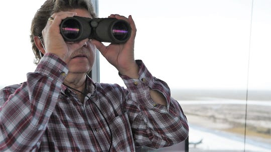 Daniel Howell, 54th Operations Support Squadron air traffic controller, observes the airfield, Dec. 18, 2018, on Holloman Air Force Base, N.M. Air traffic controllers are responsible for every aircraft and vehicle on the airfield, as well as every aircraft in flight within a 10 to 15 mile radius.