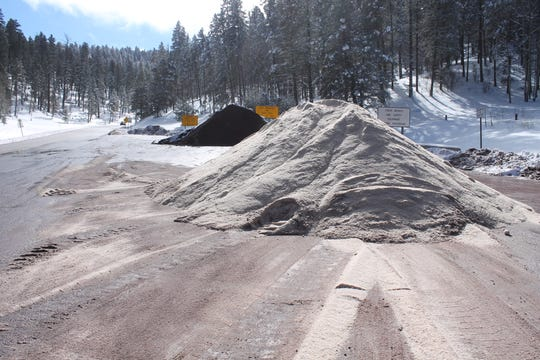 Piles of cinders and salt wait to be spread across the roads in Cloudcroft on Thursday, Dec. 27, to make the roads passable after this week's snowstorm.