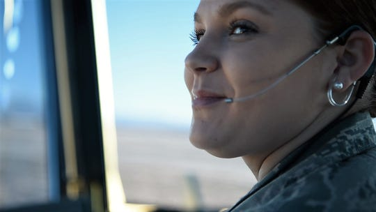 Airman 1st Class Alyssa Rogers, 54th Operations Support Squadron air traffic control trainee, observes the airfield after giving a traffic call, Dec. 18, 2018, on Holloman Air Force Base, N.M. Controllers are not authorized to give traffic calls without at least a 5-level air traffic controller observing them.