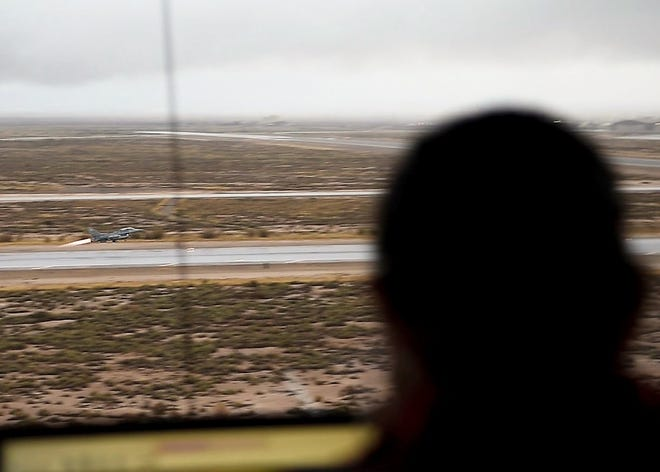 A 54th Operations Support Squadron air traffic controller observes an F-16 Fighting Falcon take off, Dec. 18, 2018, on Holloman Air Force Base, N.M. Before an F-16 can take off or land they must be in contact with the air traffic control tower to ensure the runway is clear.