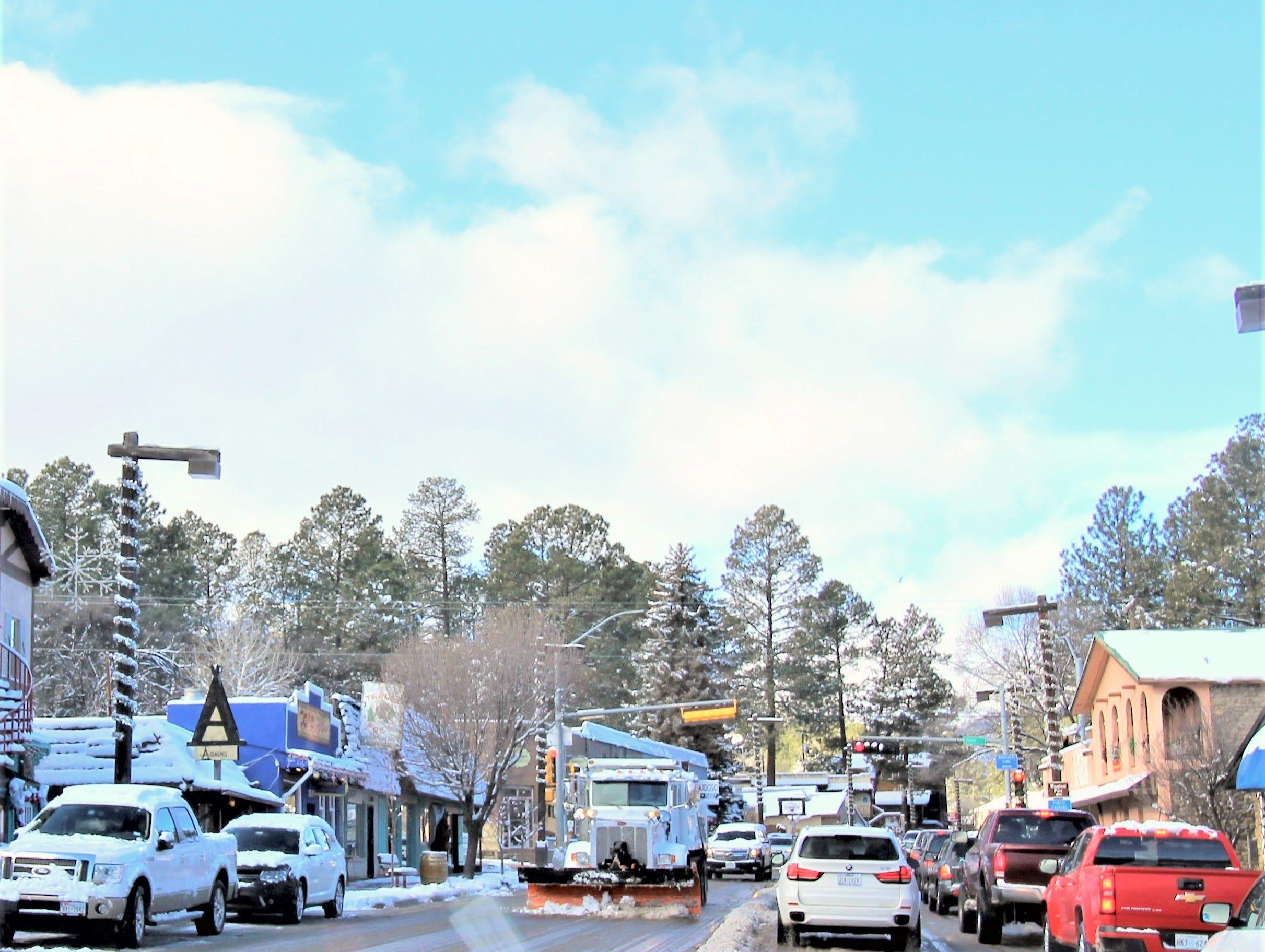 A snowplow comes through midtown Ruidoso.