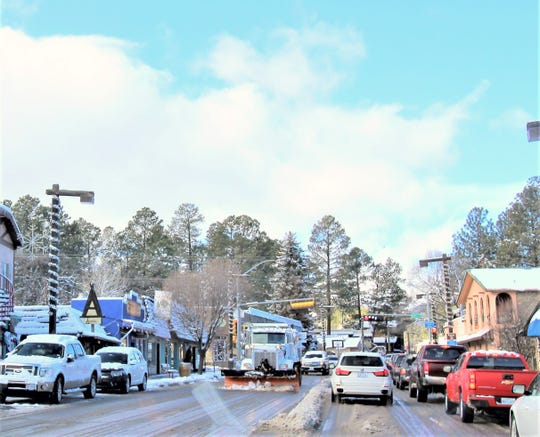 A snowplow comes through midtown Ruidoso.