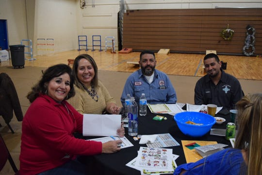 "Ruidoso Clerk Irma Devine and deputy clerk Bertha De Los Santos, far left, share games and snacks with  Jesus ""Chuy"" Lopez from the Regional Wastewater Treatment Plant and Plant Director Isaac Garcia, far right."