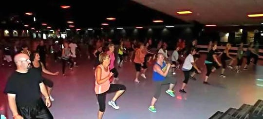 Participants get a workout with underground music and club-style lighting with D-SKO Fitness.