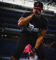 D-SKO founder Corey Sims performs at one of his fitness events.