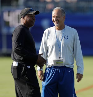 Detroit Lions head coach Jim Caldwell talks with Indianapolis Colts head coach Chuck Pagano during practice at the NFL team's football training camp Thursday, Aug. 10, 2017, in Indianapolis. (AP Photo/Darron Cummings)