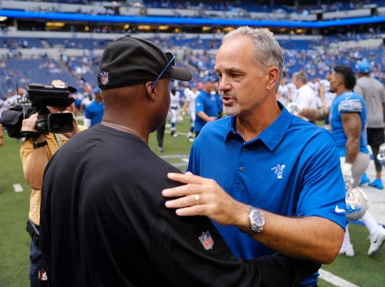 Detroit Lions head coach Jim Caldwell, left, talks with Indianapolis Colts head coach Chuck Pagano following an NFL preseason football game Sunday, Aug. 13, 2017, in Indianapolis. Detroit won 24-10. (AP Photo/AJ Mast)