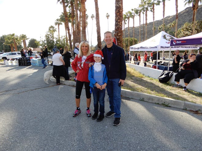 (left to right) Event Chair of 7th ANNUAL SANTA PAWS 5 K RUN Molly Thorpe, Josh Stahl, and Master of Ceremonies Jeff Stahl, KESQ TV's News Anchor & I-Team Investigator.