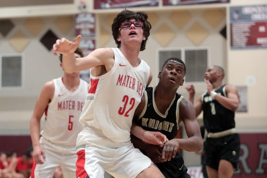 Mater Dei's Wilhelm Breidenbach eyes the rebound during play against Knight at the Rancho Mirage Holiday Inv. On Wednesday, December 26, 2018 in Rancho Mirage.