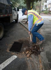 Eddie Palmer with the city of Pensacola's Public Works Department works Thursday to ensure the city's stormwater system is clear of any obstructions before rain starts to fall. The National Weather Service forecast calls for 2 to 4 inches of rain in the Pensacola area.