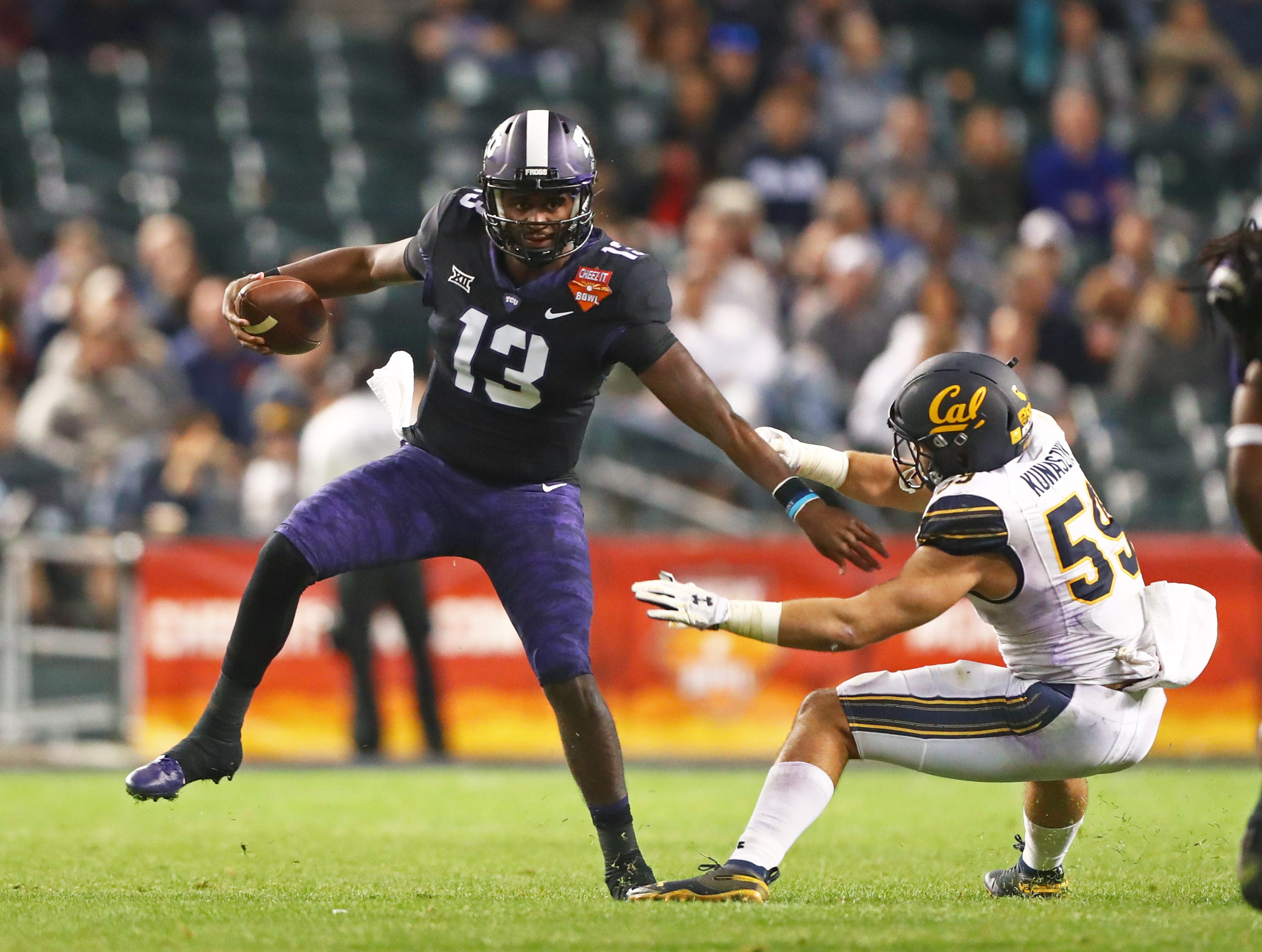 Dec 26, 2018; Phoenix, AZ, USA; Texas Christian Horned Frogs quarterback Justin Rogers (13) against California Golden Bears linebacker Jordan Kunaszyk (59) in the 2018 Cheez-It Bowl at Chase Field.