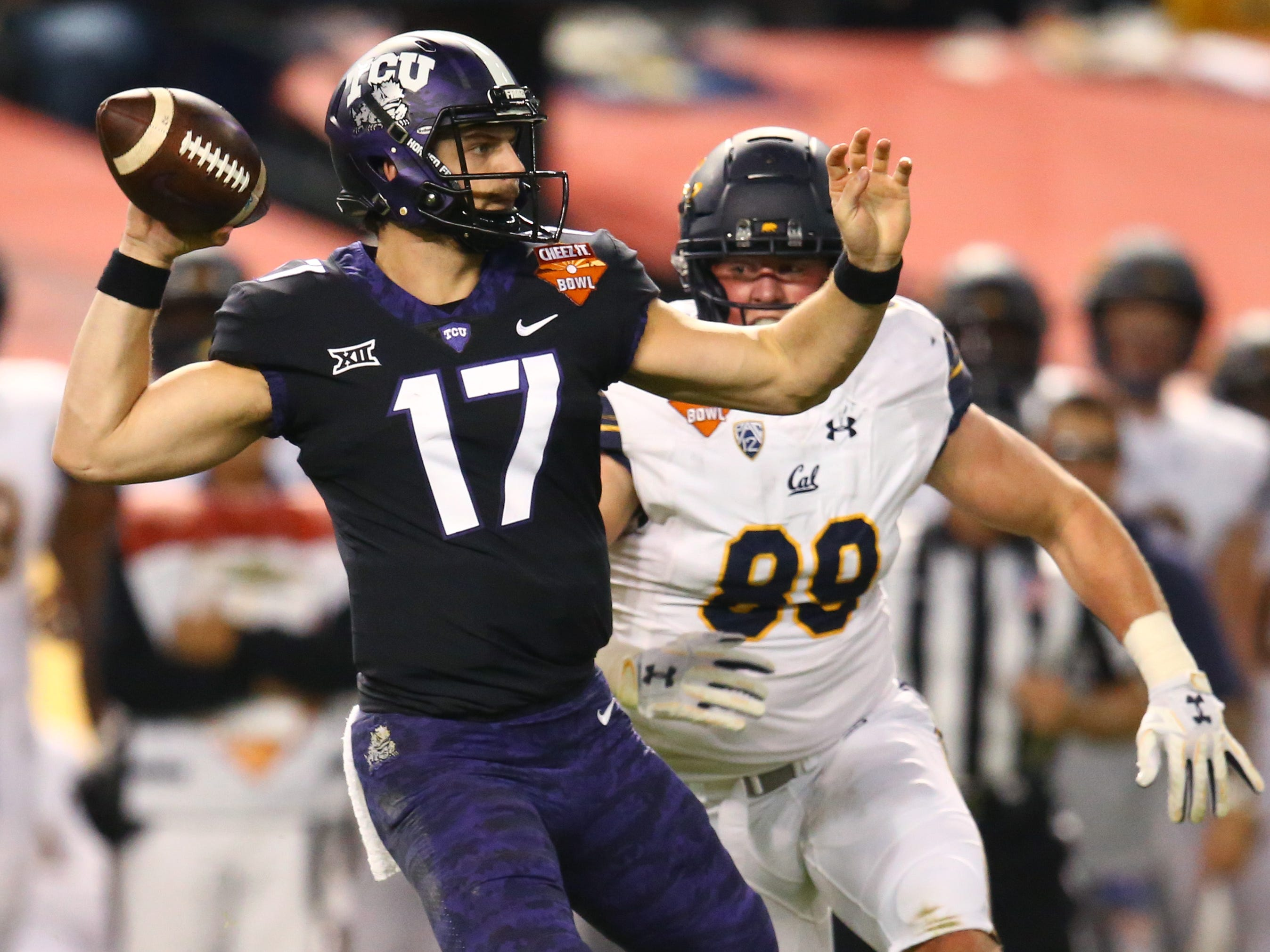 Dec 26, 2018; Phoenix, AZ, USA; Texas Christian Horned Frogs quarterback Grayson Muehlstein (17) throws a pass against the California Golden Bears in the first half of the 2018 Cheez-It Bowl at Chase Field.