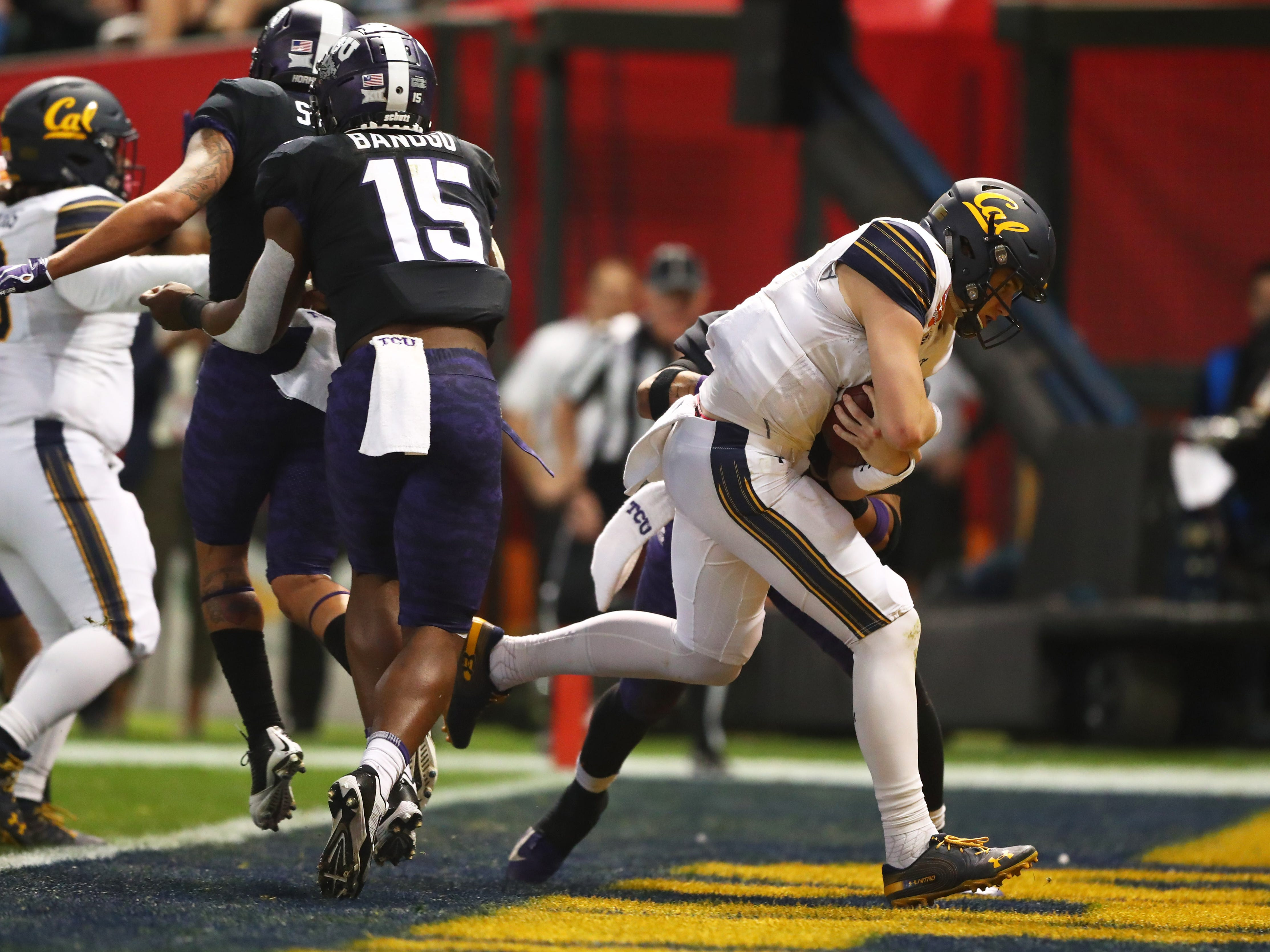 Dec 26, 2018; Phoenix, AZ, USA; California Golden Bears quarterback Chase Garbers (7) runs the ball into the end zone for a touchdown against the Texas Christian Horned Frogs in the first quarter of the 2018 Cheez-It Bowl at Chase Field.