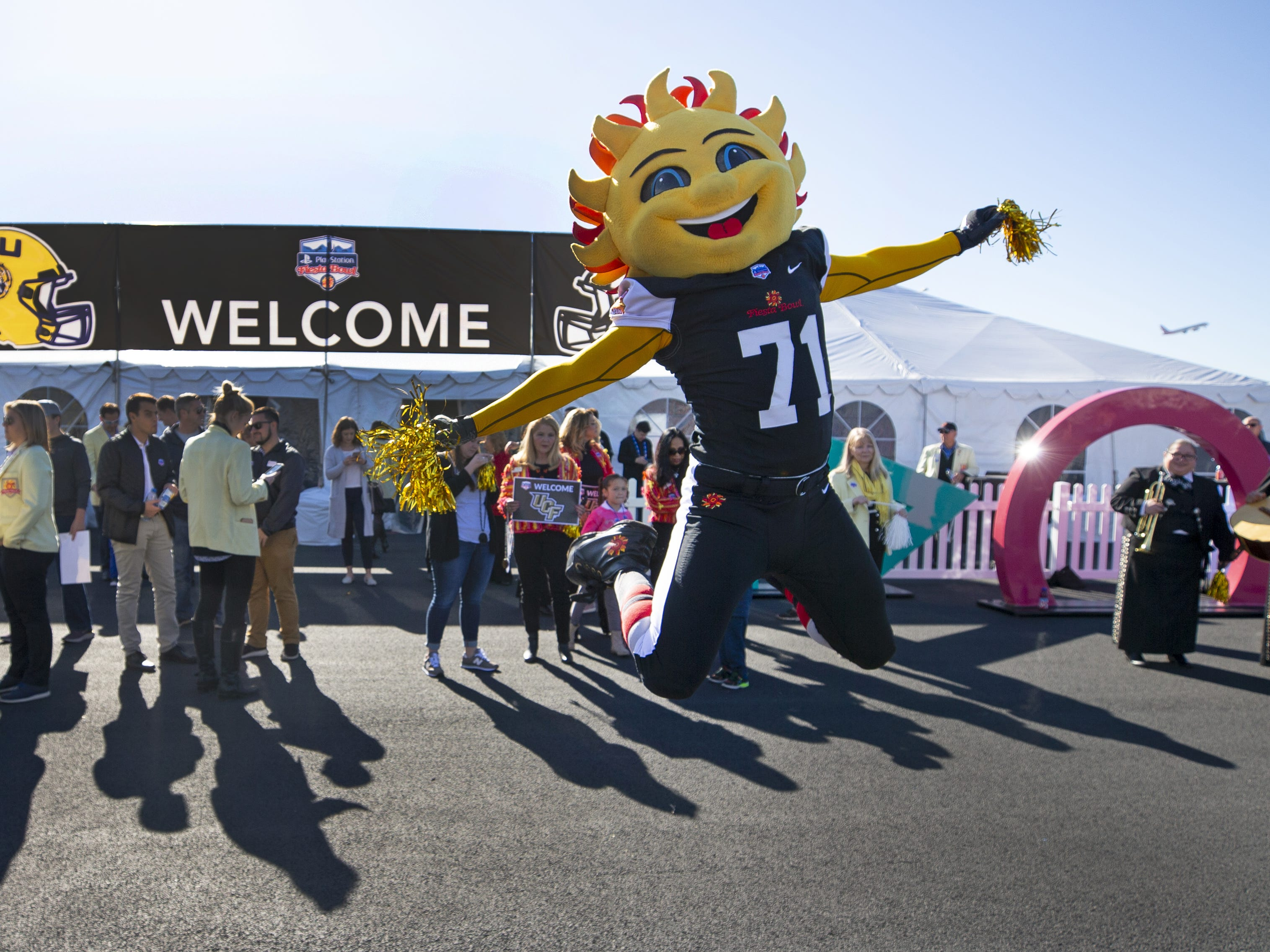 Fiesta Bowl mascot, Spirit, prepares to greet Central Florida football team at Sky Harbor International Airport in Phoenix on December 27. Central Florida will face LSU in the Fiesta Bowl on New Year's Day.