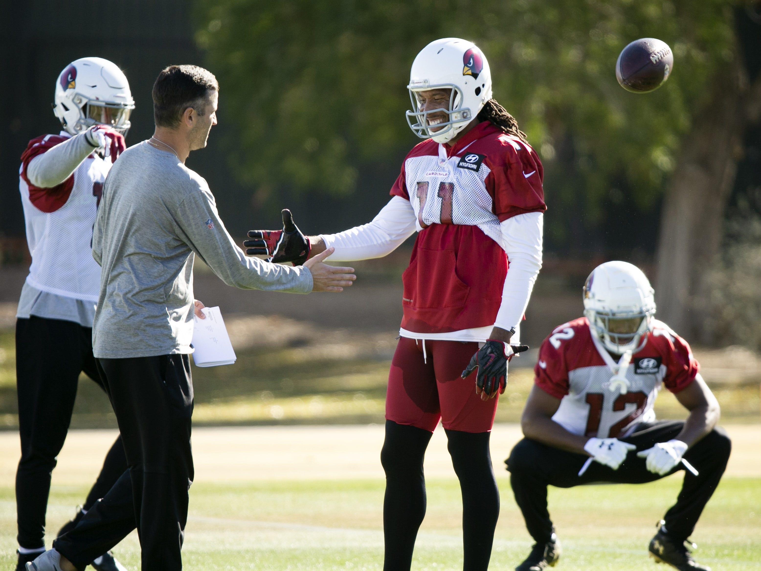 Cardinals wide receiver Larry Fitzgerald shakes hands with Cardinals wide receivers coach Kevin Garver during a practice at the Cardinals training facility in Tempe on Thursday, December 27, 2018.