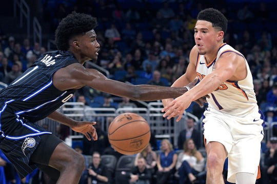 Suns guard Devin Booker finished with eight assists against the Magic.