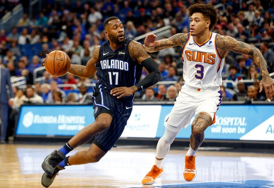 Dec 26, 2018; Orlando, FL, USA; Orlando Magic forward Jonathon Simmons (17) drives past Phoenix Suns forward Kelly Oubre Jr. (3) during the second quarter at Amway Center.