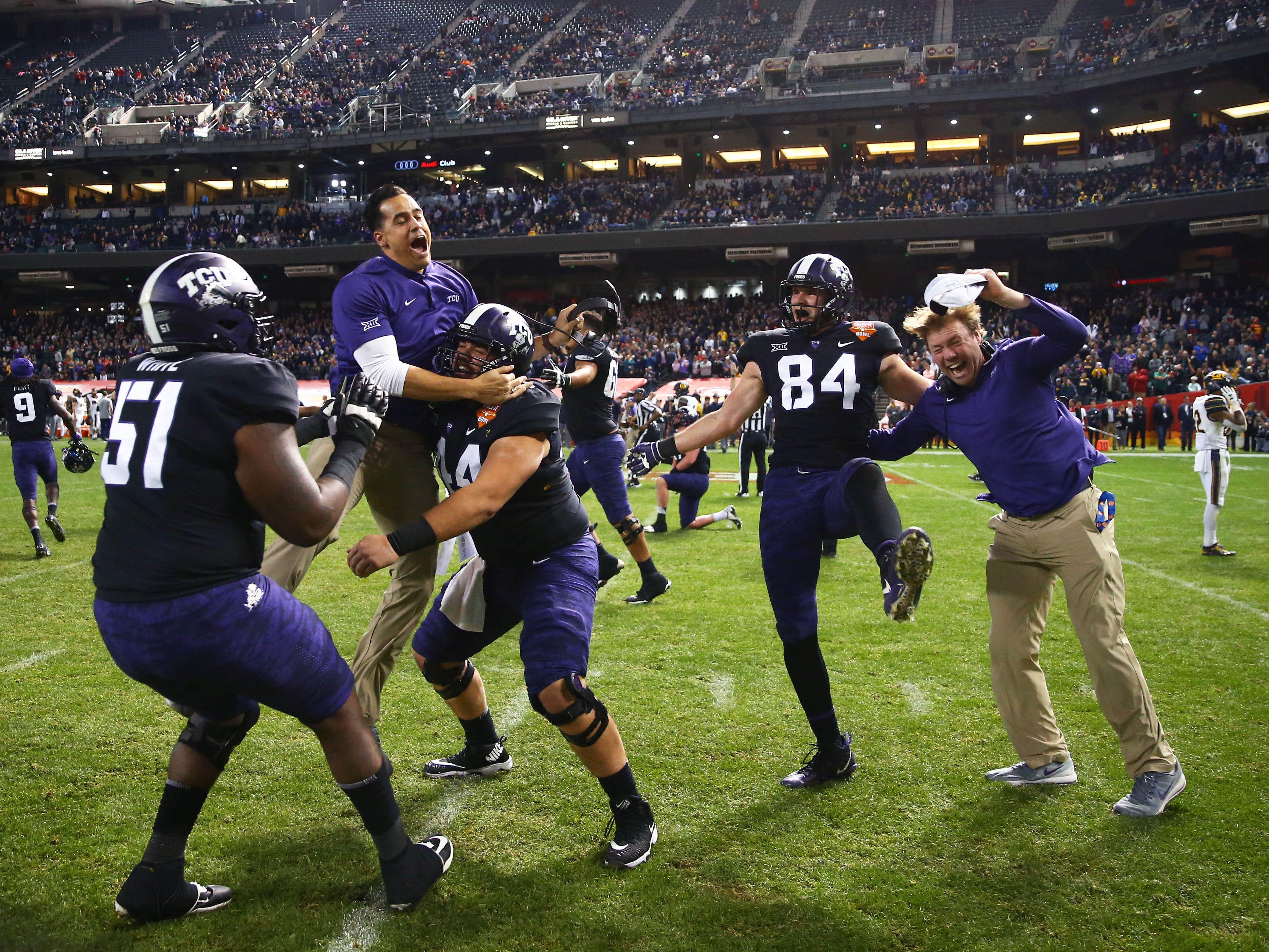 Dec 26, 2018; Phoenix, AZ, USA; Texas Christian Horned Frogs players celebrate after defeating the California Golden Bears in overtime of the 2018 Cheez-It Bowl at Chase Field.