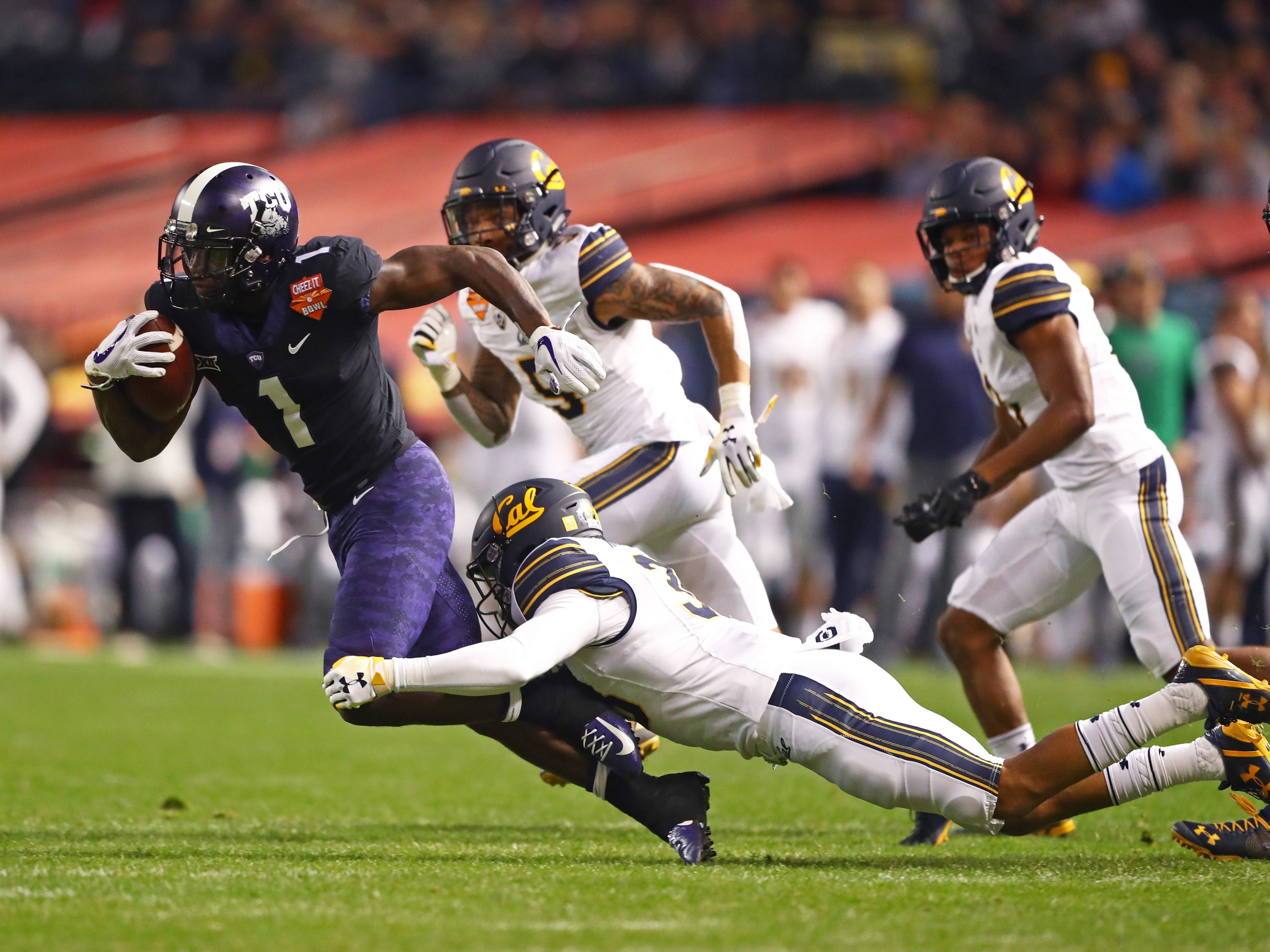 Dec 26, 2018; Phoenix, AZ, USA; Texas Christian Horned Frogs wide receiver Jalen Reagor (1) is tackled by California Golden Bears linebacker Matt Horwitz (38) in the first half of the 2018 Cheez-It Bowl at Chase Field.
