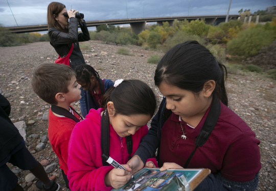 Yhitzelle Bernal (center), 8, and Johana Lugo (right), 10, from the Tri-City West Thornwood Branch of Avondale of the Boys & Girls Clubs of Metro Phoenix, bird-watch at the Nina Mason Pulliam Rio Salado Audubon Center in Phoenix on Dec. 6, 2018.