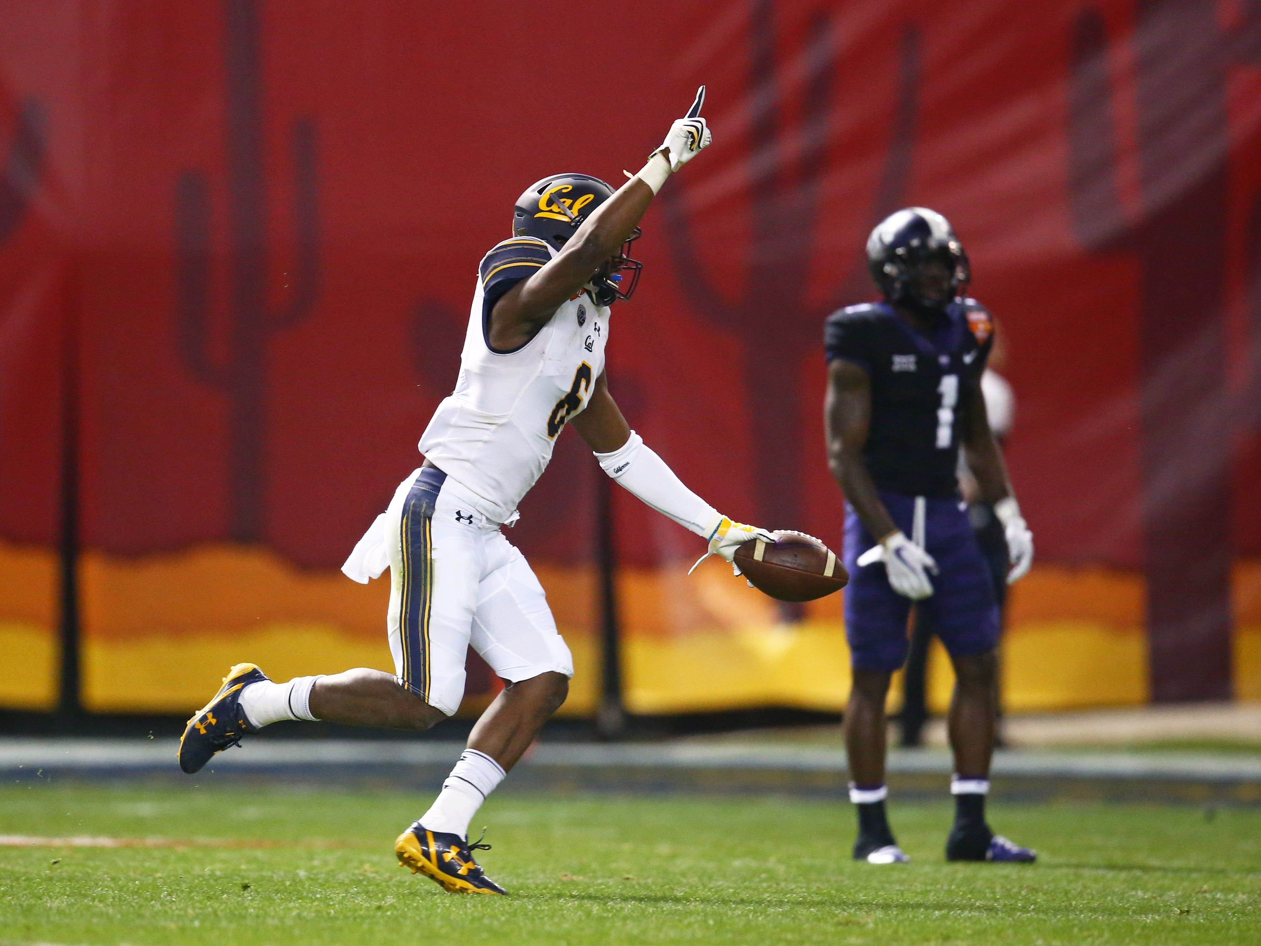 Dec 26, 2018; Phoenix, AZ, USA; California Golden Bears safety Jaylinn Hawkins (6) celebrates after an interception against the Texas Christian Horned Frogs in the first half of the 2018 Cheez-It Bowl at Chase Field.