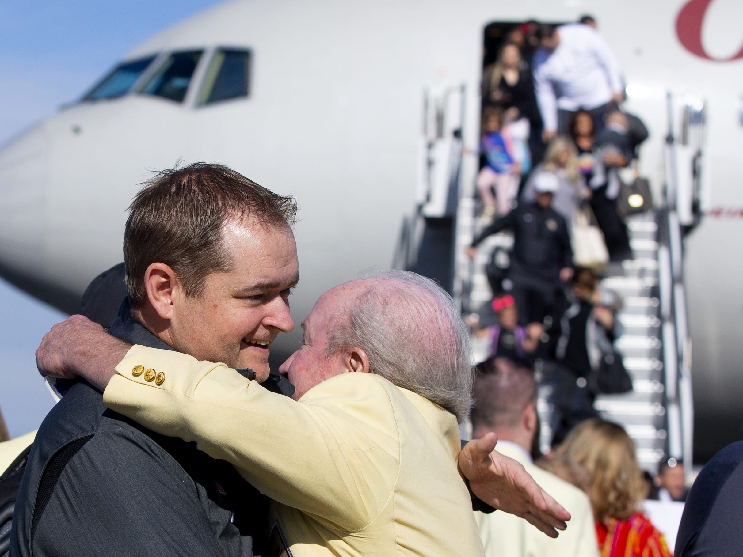 Central Florida head football coach Josh Heupel is greeted by Frank Divers, 2016-17 Fiesta Bowl chairman, at Sky Harbor International Airport in Phoenix on December 27. Central Florida will face LSU in the Fiesta Bowl on New Year's Day.