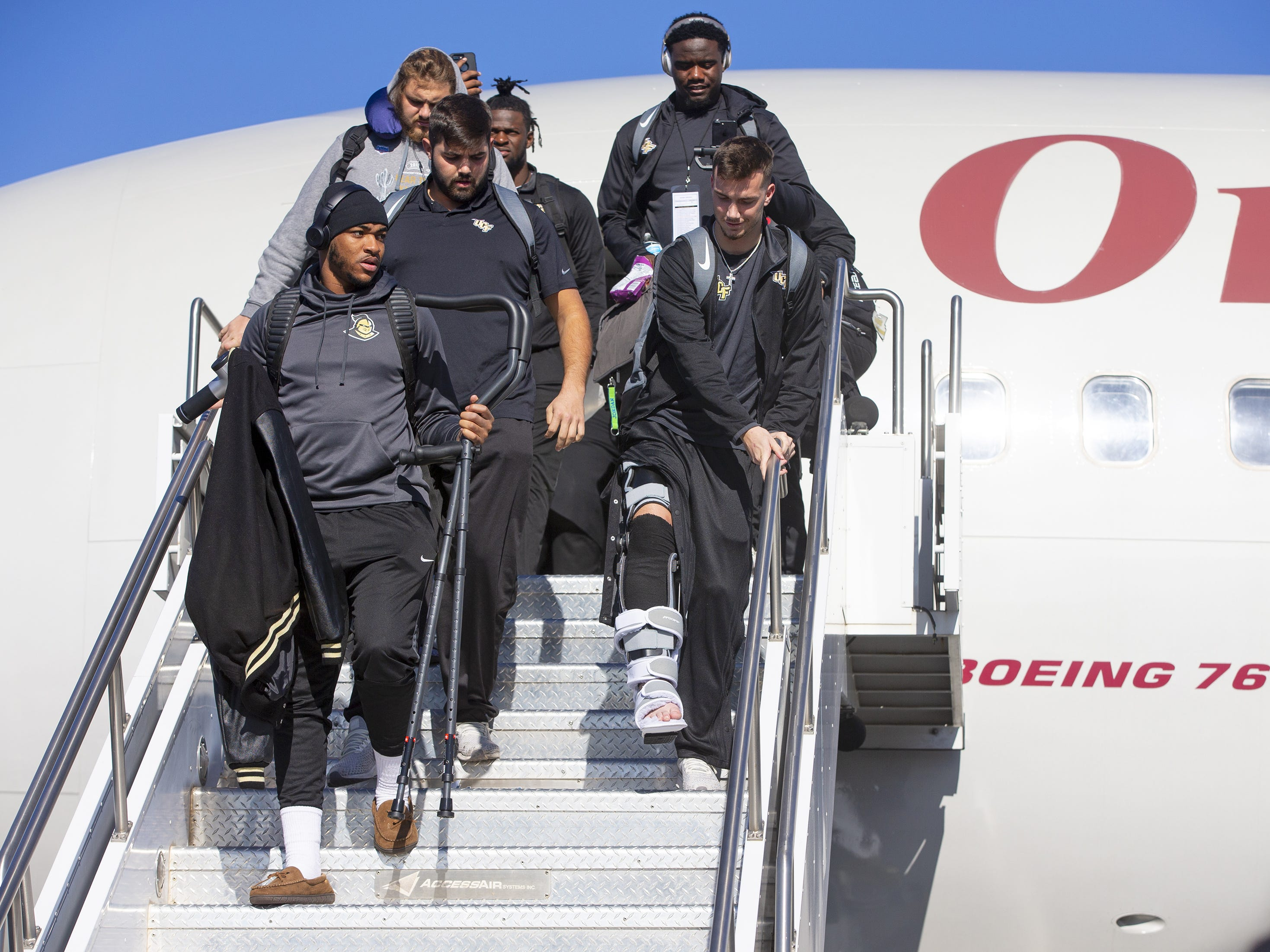 Injured Central Florida quarterback McKenzie Milton, arrives with his team at Sky Harbor International Airport in Phoenix on December 27. Central Florida will face LSU in the Fiesta Bowl on New Year's Day.