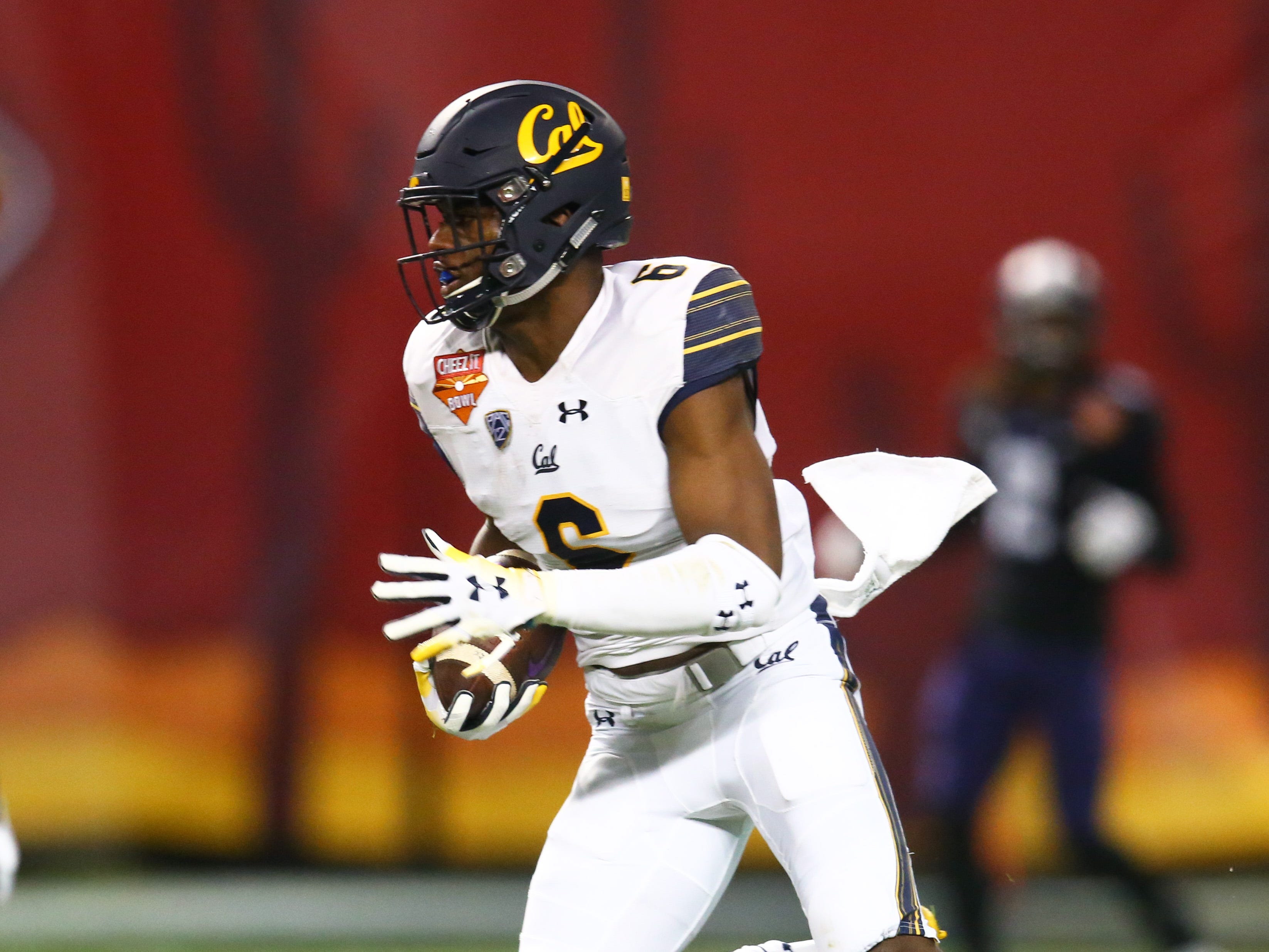 Dec 26, 2018; Phoenix, AZ, USA; California Golden Bears safety Jaylinn Hawkins (6) returns after an interception against the Texas Christian Horned Frogs in the first half of the 2018 Cheez-It Bowl at Chase Field.