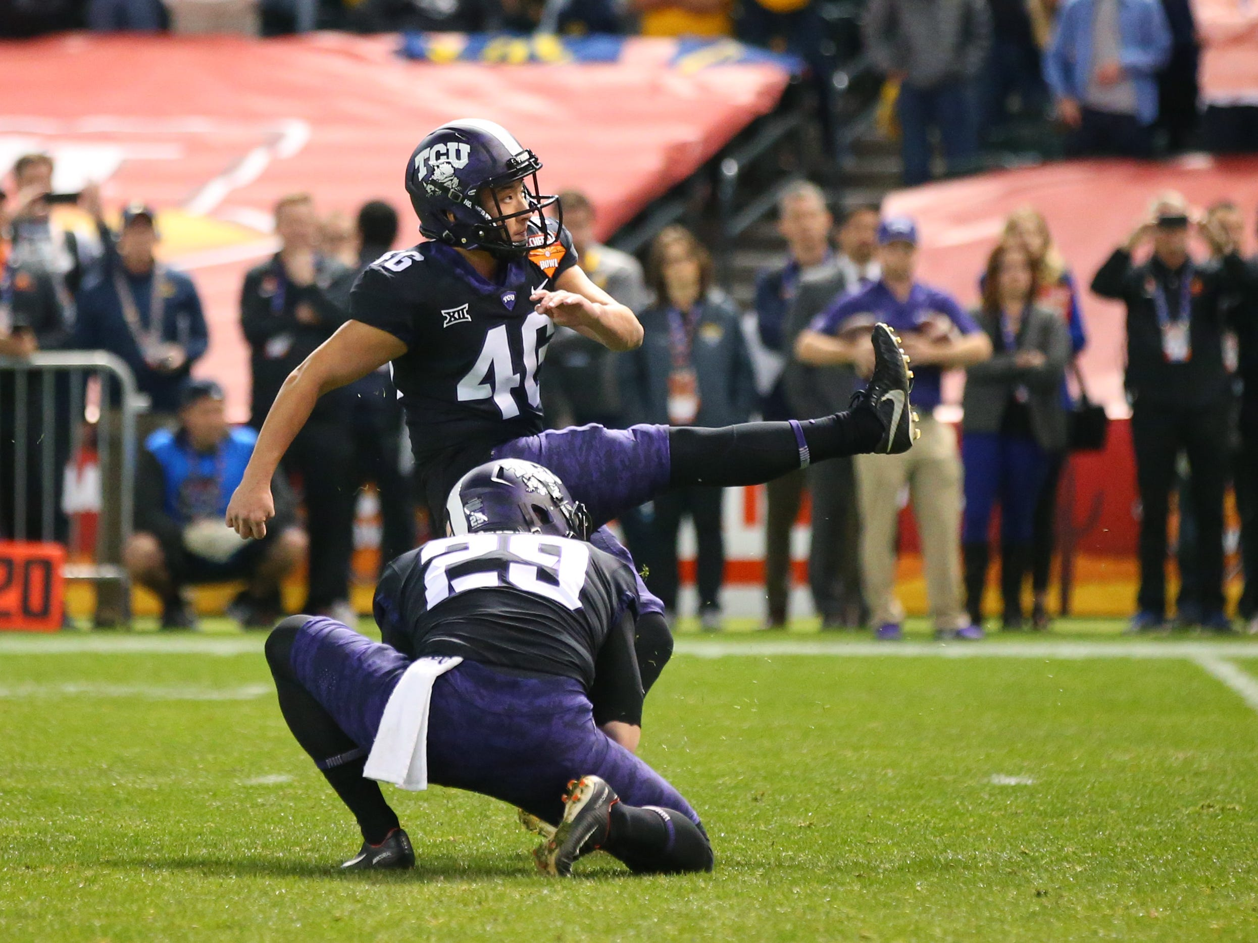 Dec 26, 2018; Phoenix, AZ, USA; Texas Christian Horned Frogs kicker Jonathan Song kicks the game winning field goal against the California Golden Bears in overtime of the 2018 Cheez-It Bowl at Chase Field.