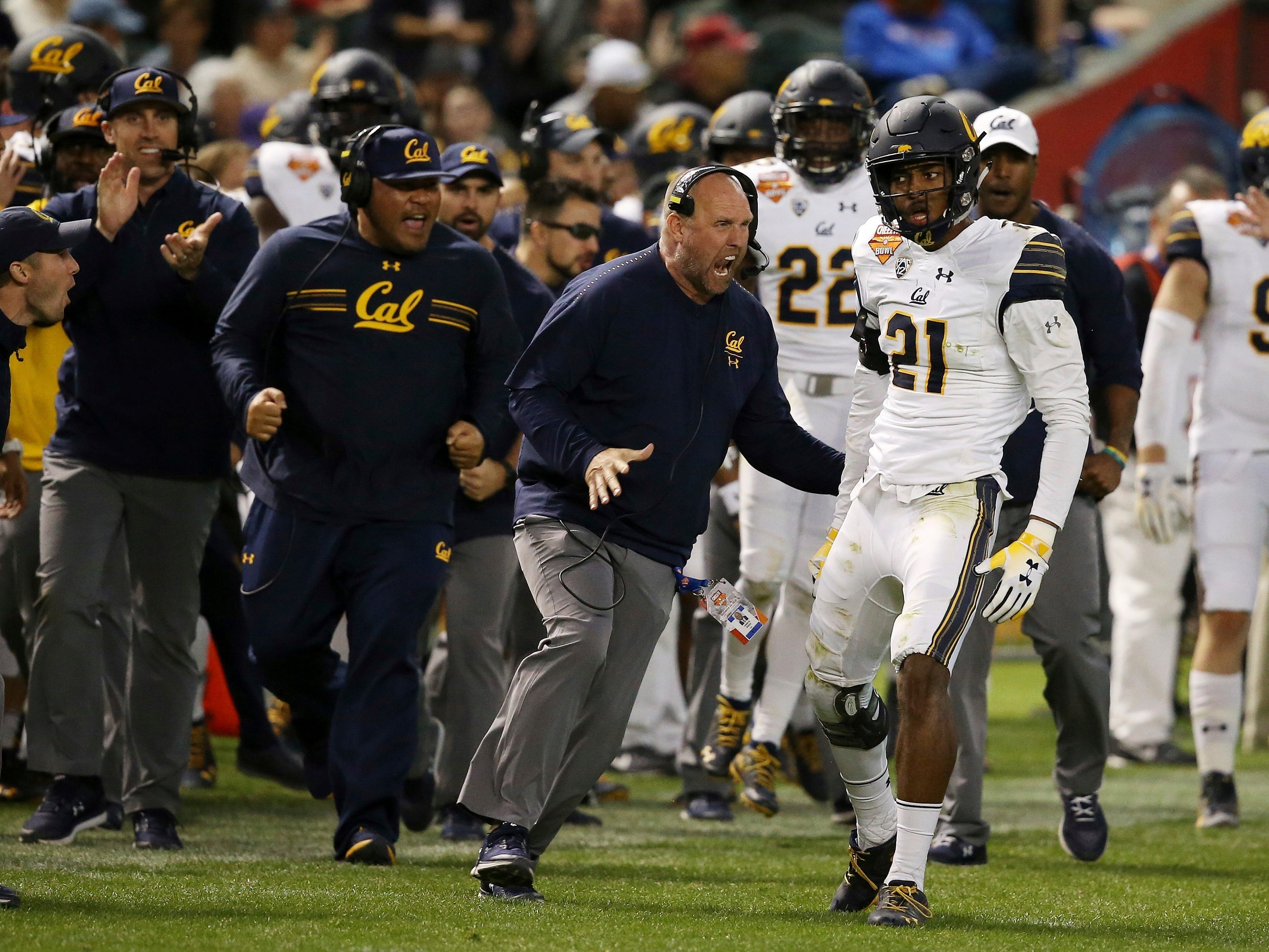 California safety Evan Rambo (21) celebrates his tackle for a loss against TCU with some of the coaches during the first half of the Cheez-It Bowl NCAA college football game Wednesday, Dec. 26, 2018, in Phoenix.