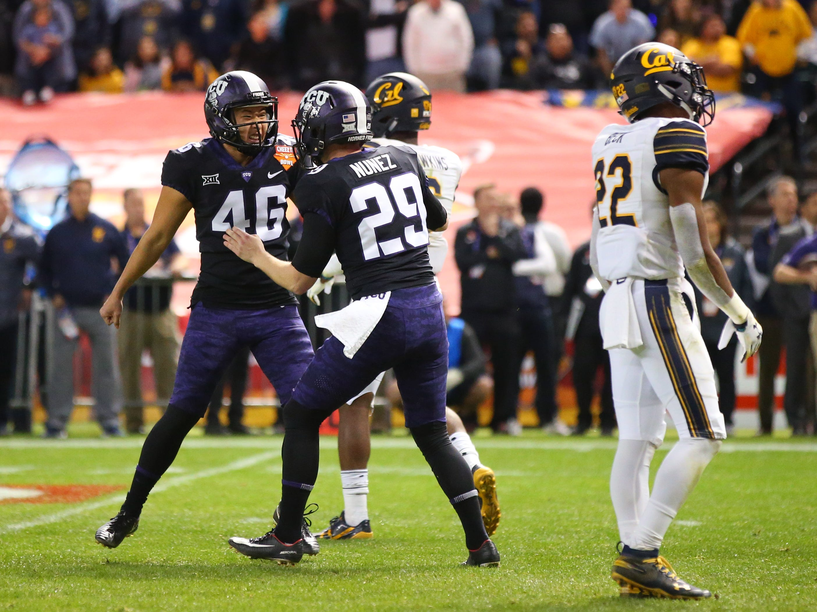 Dec 26, 2018; Phoenix, AZ, USA; Texas Christian Horned Frogs kicker Jonathan Song (46) celebrates with Adam Nunez (29) after kicking the game winning field goal against the California Golden Bears in overtime of the 2018 Cheez-It Bowl at Chase Field.