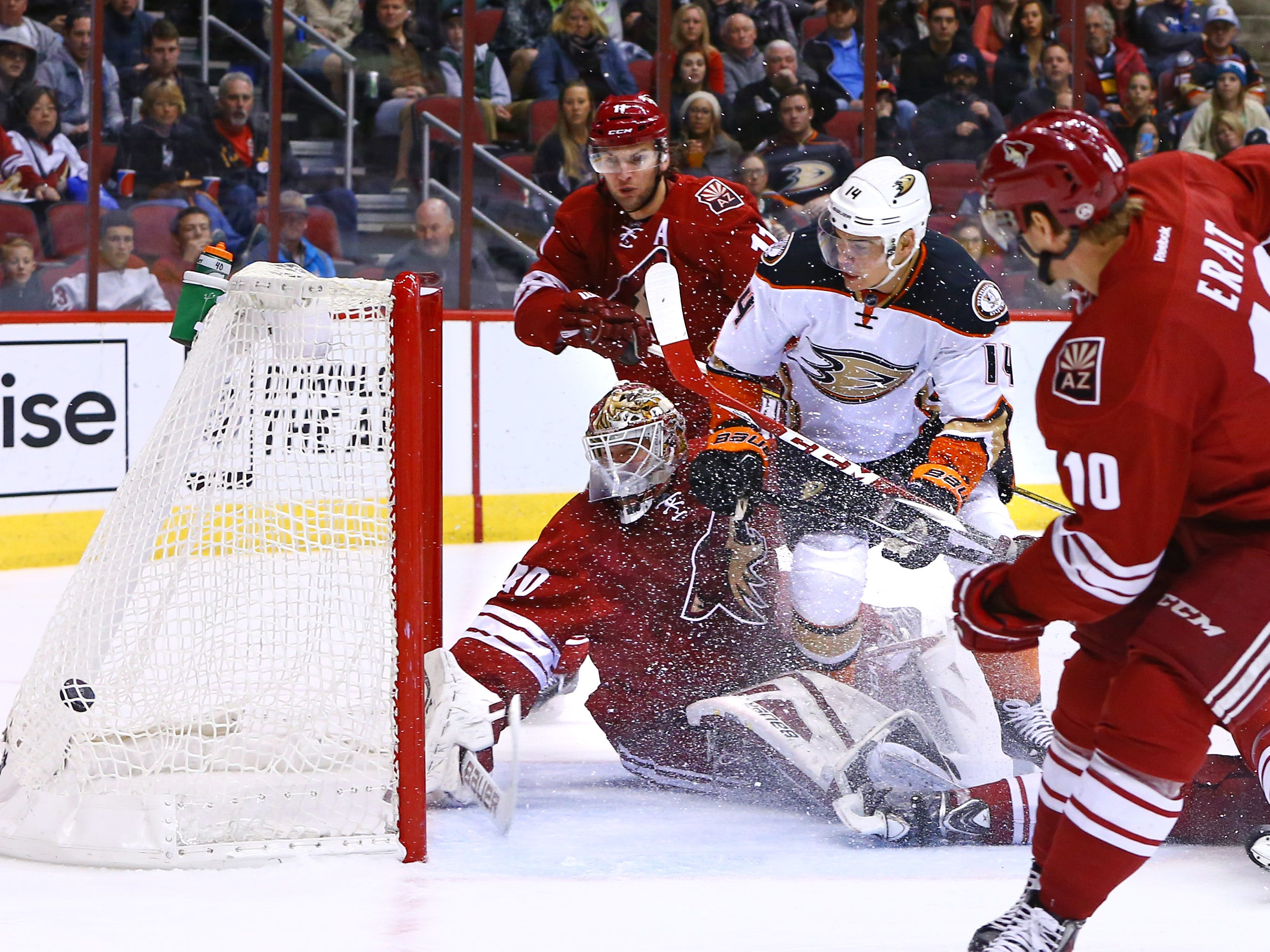 Dec 27, 2014; Glendale, AZ, USA; Anaheim Ducks left wing Rene Bourque (14) scores a goal against Arizona Coyotes goalie Devan Dubnyk (40) in the first period at Gila River Arena. Mandatory Credit: Mark J. Rebilas-USA TODAY Sports