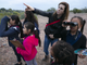Emily Martell, a teacher/naturalist with the Nina Mason Pulliam Rio Salado Audubon Center, points to a bird while bird-watching with kids from the Tri-City West Thornwood Branch of Avondale of the Boys & Girls Clubs of Metro Phoenix, on Dec. 6, 2018.