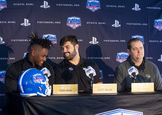 Central Florida defensive lineman, Titus Davis, offensive lineman, Wyatt Miller, and head football coach Josh Heupel speak to the media after arriving at Sky Harbor International Airport in Phoenix on December 27. Central Florida will face LSU in the Fiesta Bowl on New Year's Day.